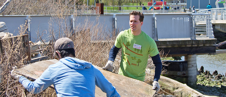 New York Cares Day Spring Two Men Volunteers Removing Trash in Park