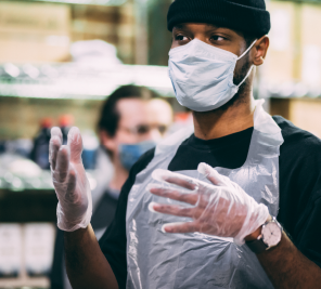 Male volunteer wearing gloves and mask