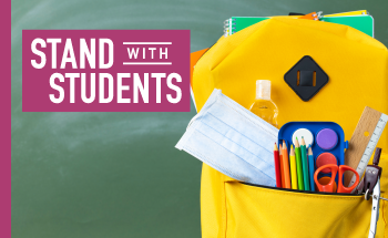 Backpack filled with school supplies and Stand with Students logot