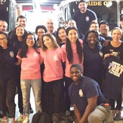 Volunteers from Big Apple Church smile with the FDNY.