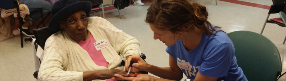 Volunteer Giving a Manicure to Senior